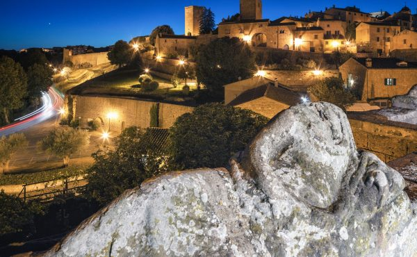 Tuscania, Viterbo, Lazio, Italy - Etruscan sarcophagus at belvedere before Torre di Lavello at timelapse.